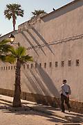 Man walking by wall in Cadiz, Spain