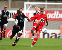 Photo: Chris Ratcliffe.<br />Leyton Orient v Swansea City. Coca Cola League 1. 26/08/2006.<br />Justin Miller (R) of Leyton Orient clashes with Leon Knight of Swansea.