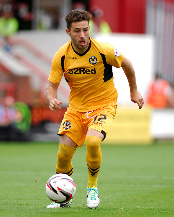 Newport County's Robbie Willmott in action during todays match  <br /> <br /> Photo by Ashley Crowden/CameraSport<br /> <br /> Football - The Football League Sky Bet League Two - Exeter City v Newport County - Saturday 21st September 2013 - St James Park - Exeter<br /> <br /> © CameraSport - 43 Linden Ave. Countesthorpe. Leicester. England. LE8 5PG - Tel: +44 (0) 116 277 4147 - admin@camerasport.com - www.camerasport.com
