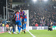 Ball boy celebrate 2nd goal for Crystal Palace together with #11 Wilfried Zaha, Crystal Palace, Crystal Palace #15 Jeffrey Schlupp, Crystal Palace #26 Bakary Sako during the Premier League match between Crystal Palace and Watford at Selhurst Park, London, England on 12 December 2017. Photo by Sebastian Frej.