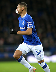 Everton's Richarlison runs around the pitch with tissue in his mouth after picking up an injury during the match