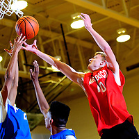 040413       Adron Gardner<br /> <br /> New Mexico All-Star and Ramah Mustang Sean Jordan (10), right,  reaches for a rebound during the boys All-Star game at Miyamura High School in Gallup Thursday.