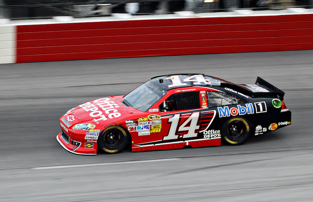 May 12, 2012; Darlington, SC, USA; NASCAR Sprint Cup driver Tony Stewart (14) during the Southern 500 at Darlington Raceway. Mandatory Credit: Peter Casey-US PRESSWIRE.