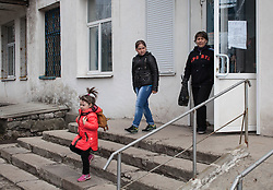 Valentina, 34, Diana, 10, and Shezhana,4, leave the MSF mobile clinic run in the Zorinsk health centre, having seen an MSF doctor and collecting prescribed medicines.