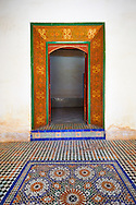 Berber Arabesque painted wood door surround and Zellige tile floor.The Petite Court, Bahia Palace, Marrakesh, Morroco .<br /> <br /> Visit our MOROCCO HISTORIC PLAXES PHOTO COLLECTIONS for more   photos  to download or buy as prints https://funkystock.photoshelter.com/gallery-collection/Morocco-Pictures-Photos-and-Images/C0000ds6t1_cvhPo<br /> .<br /> <br /> Visit our ISLAMIC HISTORICAL PLACES PHOTO COLLECTIONS for more photos to download or buy as wall art prints https://funkystock.photoshelter.com/gallery-collection/Islam-Islamic-Historic-Places-Architecture-Pictures-Images-of/C0000n7SGOHt9XWI
