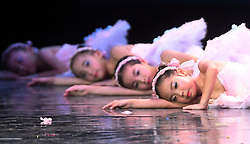 July 30, 2017: Nanning, China: Children competitors dance during the Guangxi zone of a national children's ballet contest in Nanning, capital of the southwest China's Guagnxi Zhuang Autonomous Region. The contest kicked off here on Sunday, attracting around 1,000 young dancers of 50 groups in the region. (Credit Image: © Zhang Ailin/Xinhua via ZUMA Wire)