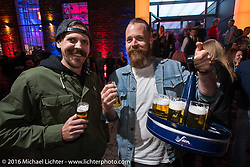 Cameron Brewer having a great evening at an Intermot sponsored party at the very cool New Yorker / Dock One warehouse after another day at the Intermot Motorcycle Trade Fair. Cologne, Germany. Thursday October 6, 2016. Photography ©2016 Michael Lichter.