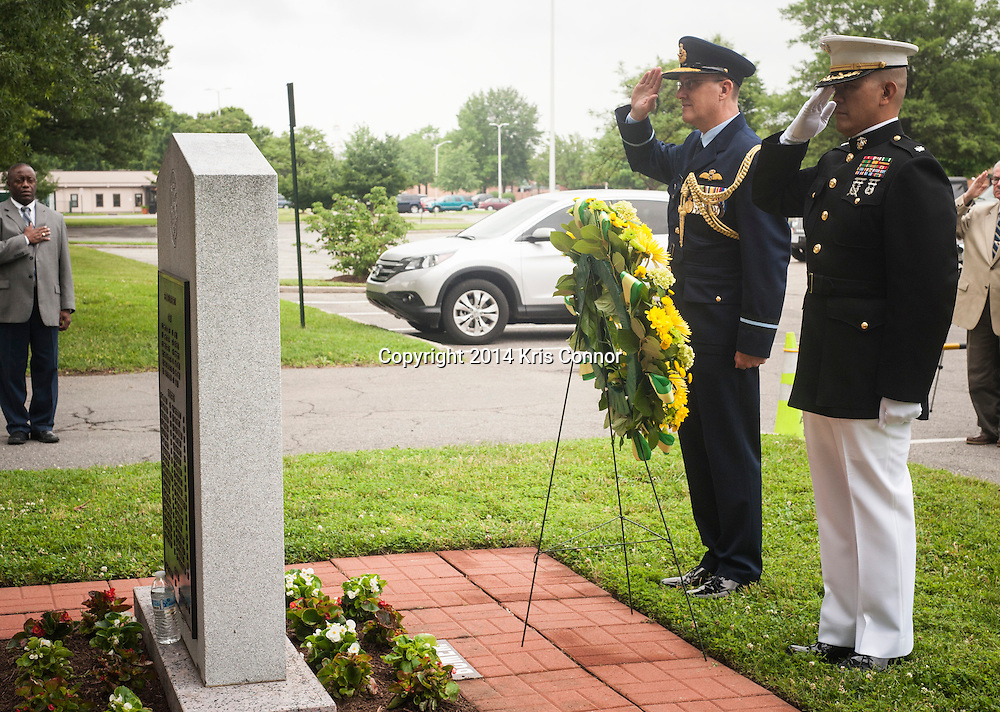 Australian Air Commodore Gary Martin speaks and Lt. Col John Orille(R), Deputy Base Command of Joint Base Myer-Henderson Hall lay a reef during a ceremony marking 71th anniversary of a crash that killed 40 Army Air Corps members at Bakers Creek, Australia at Joint Base Myer-Henderson Hall in Arlington, Va. on June 13, 2014. Photo by Kris Connor