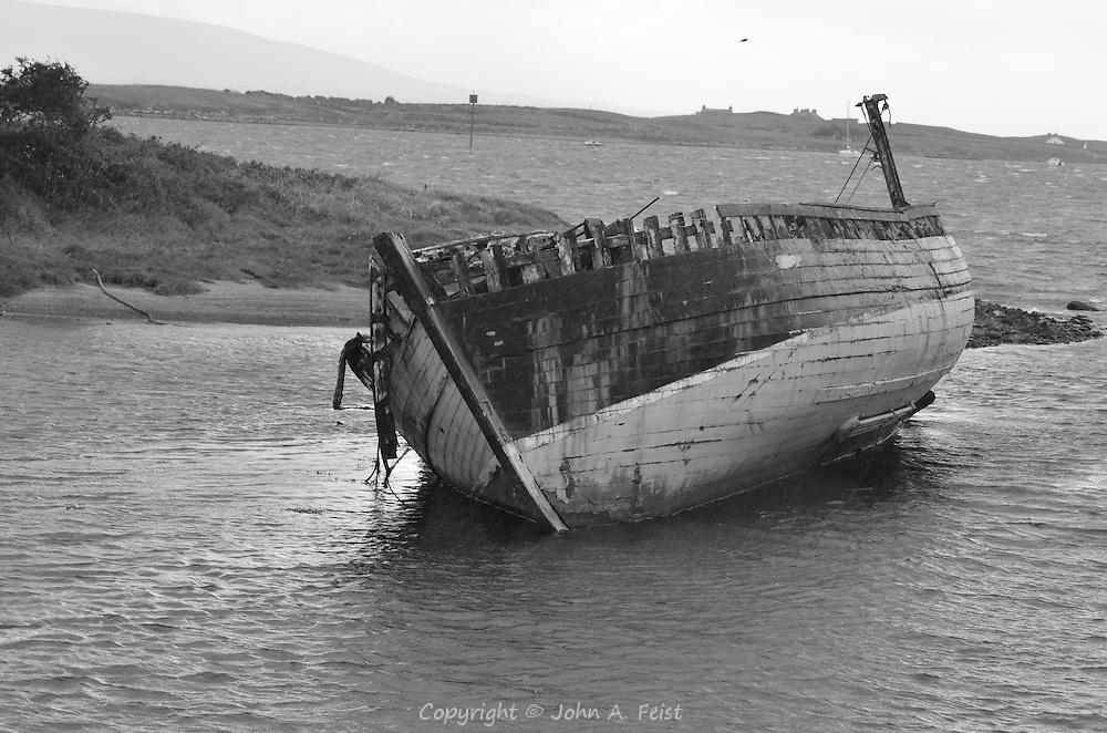 A derelict hull in the waters at Sligo, County Sligo, Ireland in black and white.