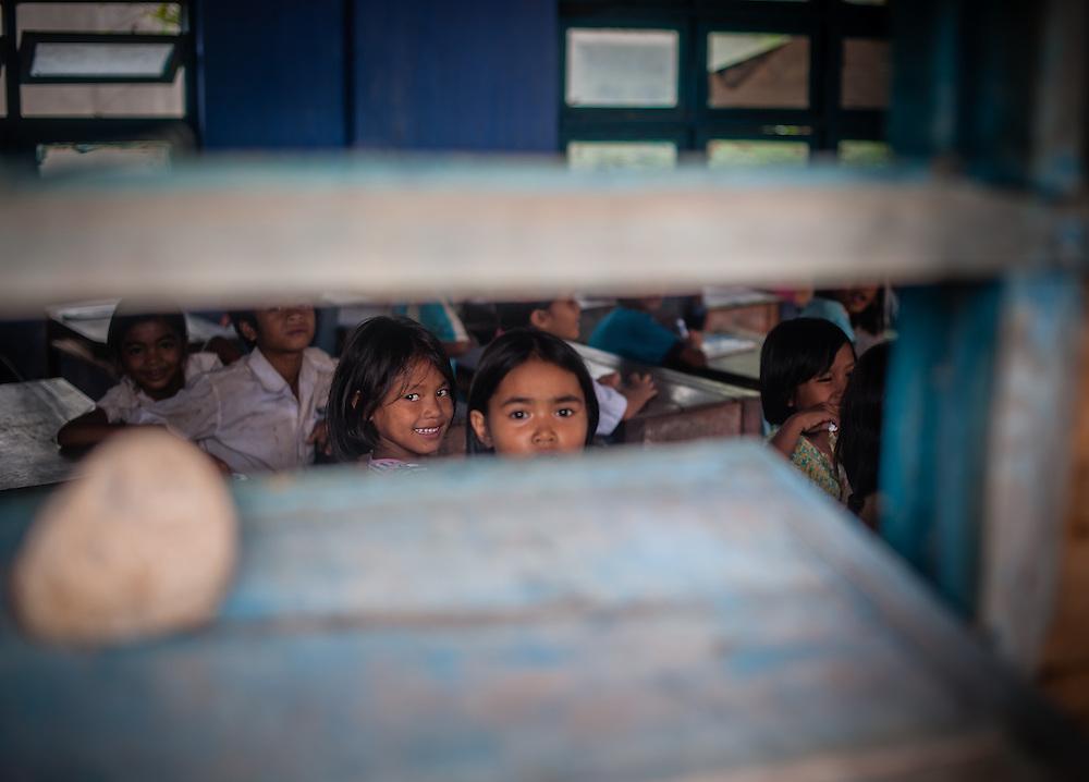 Students looking through school window (Vietnam)