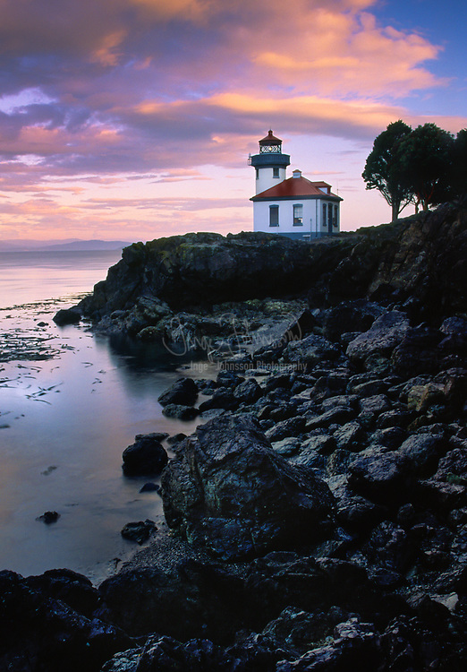 The Lime Kiln light, a name derived from the lime kilns built nearby in the 1860s, was first established in 1914. It was the last major light established in Washington. The lighthouse was updated five years later with a 38-foot octagonal concrete tower rising from the fog signal building. A fourth-order Fresnel lens was first exhibited from the new tower on June 30, 1919. The Coast Guard automated the Lime Kiln Lighthouse in August 1962, using photoelectric cells to turn the light on at dusk and off during daylight hours. In 1998, the drum lens was replaced with a modern optic, flashing a white light once every 10 seconds. Sitting on the rocky shoreline at a height of 55 feet, the beacon is visible for 17 miles.