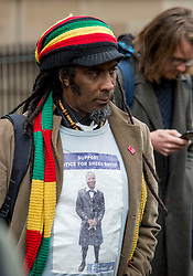 A supporter of the family of Sheku Bayoh outside the Crown Office.<br /> <br /> © Dave Johnston / EEm