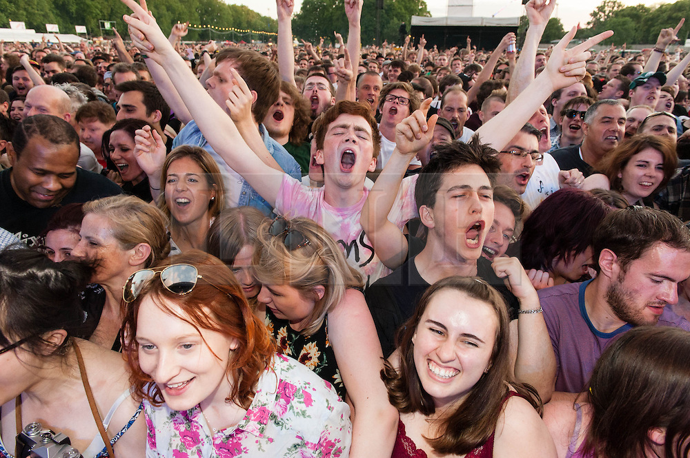© Licensed to London News Pictures. 08/06/2014. London, UK.  Festival atmosphere at Field Day Festival 2014 - music fans cheer The Pixies as they come onstage.  Field Day is an annual outdoor music festival which takes place in Victoria Park in London.    Photo credit : Richard Isaac/LNP