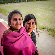 Two young Kichwa woman friends at Kapak Raymi ceremony in Cotacachi, Ecuador