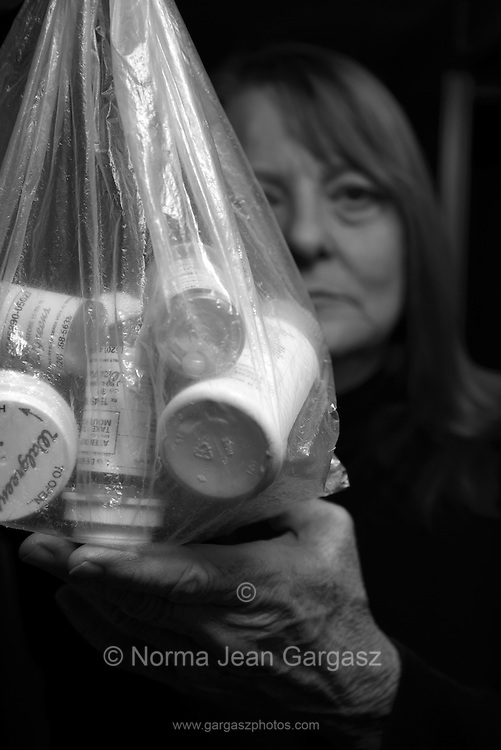 Prescription drugs taken by a woman with chronic illness.