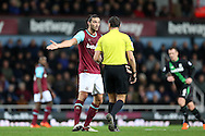 Andy Carroll of West Ham United talks with Referee Andre Marriner . Barclays Premier league match, West Ham Utd v Stoke city at the Boleyn Ground, Upton Park  in London on Saturday 12th December 2015.<br /> pic by John Patrick Fletcher, Andrew Orchard sports photography.