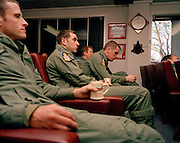 Pilots of the Red Arrows, Britain's RAF aerobatic team endure a post-flight de-brief in the squadron crew room at RAF Scampton.