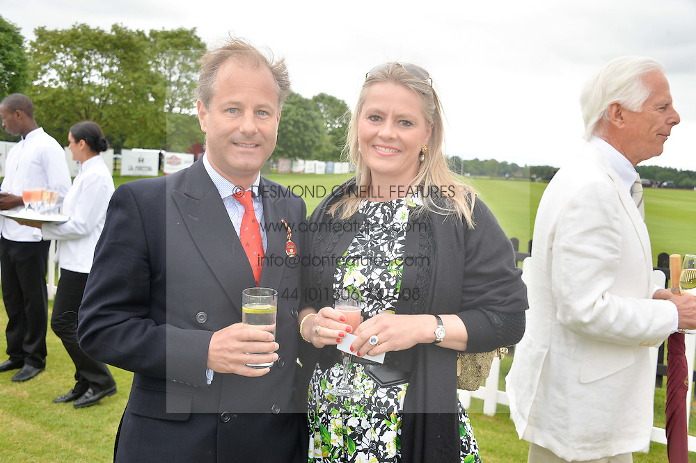 VISCOUNT & VISCOUNTESS CHELSEA at the Cartier Queen's Cup Final polo held at Guards Polo Club, Smith's Lawn, Windsor Great Park, Egham, Surrey on 15th June 2014.