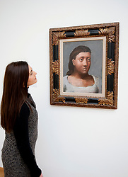 Woman looking at painting Sibylle by Pablo Picasso at the Gemeentemuseum in The Hague, Den Haag,  Netherlands