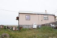 Ett hem i Shishmaref beläget precis bredvid vattnet på grund av erosionen som ätit sig allt närmare fastigheten. För att undvika en fortsatt erosion har en vall av sten lagts som skydd mot vågorna. Alaska, USA<br /> <br /> Fotograf: Christina Sjögren<br /> <br /> Photographer: Christina Sjogren<br /> Copyright 2018, All Rights Reserved