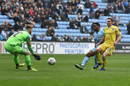 Bristol Rovers forward Gavin Reilly (20) sees his shot stopped by Coventry City goalkeeper Lee Burge (1) during the EFL Sky Bet League 1 match between Coventry City and Bristol Rovers at the Ricoh Arena, Coventry, England on 7 April 2019.