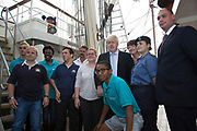 London, UK. Monday 8th September 2014. London Mayor Boris Johnson poses with crew members during a visit to Royal Greenwich Tall Ships Festival which is organized by RB Greenwich, aboard the vessel TS Tenacious. The Festival is included as a highlight of Totally Thames, the new month-long promotion of river and riverside events delivered by Thames Festival Trust.