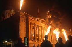 Nottingham council house lit by flames at night,