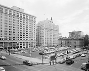"""Ackroyd 03589-1 """"Meier & Frank parking lot. shot from roof-top of drug store on Broadway."""" May 1, 1952 (view from the southwest corner of Broadway and Yamhill. 8x10"""" negative. Now Pioneer Courthouse Square)"""