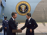 Vice President Bush (Bush 41) shakes hands with President Ronald Reagan as he arrives in New Orleans for the Republican Convention in 1988..Photograph by Dennis Brack bb30
