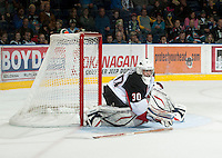 KELOWNA, CANADA - OCTOBER 18:  Marc Engel #30 of the Prince George Cougars reaches for a loose stick as the Prince George Cougars visit the Kelowna Rockets on October 18, 2012 at Prospera Place in Kelowna, British Columbia, Canada (Photo by Marissa Baecker/Shoot the Breeze) *** Local Caption ***