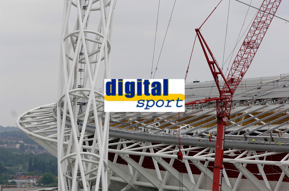 Photo: Daniel Hambury.<br /> Wembley Stadium. 14/06/2006.<br /> A detail showing part of the famous arch and roof of the new home of English football, Wembley, seen from the roof of the nearby Ibis hotel.
