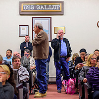 031015       Cable Hoover<br /> <br /> Gallup mayor Jackie McKinney, center, and other candidates and supporters wait for the polling results inside City Hall in Gallup Tuesday.
