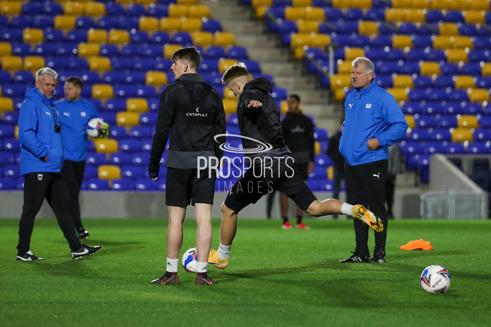 AFC Wimbledon striker Joe Pigott (39) shooting at goal with AFC Wimbledon manager Glyn Hodges watching during the test event for AFC Wimbledon held at the new Plough Lane Stadium, London, United Kingdom on 2 November 2020.