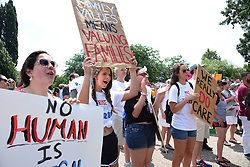 Responding to the speakers, from left, are Kyla Mullaney, 16; Robin Azzam, 14; Misaria Porter, 16 and Audrey Azzam, 16, as about 1,500 protestors attend an immigration rally in Baltimore on Saturday, June 30, 2018. Photo by Algerina Perna/Baltimore Sun/TNS/ABACAPRESS.COM