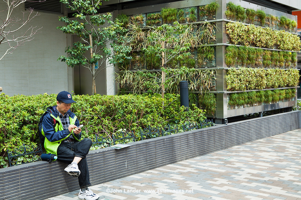 Another old idea that has been revisited, planting a green  wall blocks the sun and cools buildings down. Not only does it save energy but looks a lot better than man-made  materials. This one is cooling air conditioner inverters in front of Komagome Railway Station in Tokyo.