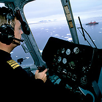 FRANZ JOSEF LAND, RUSSIA. Helicopter pilot Marko Ruzhin Flies near Cape Tegethoff, enroute to the nuclear-powered icebreaker, Yamal.