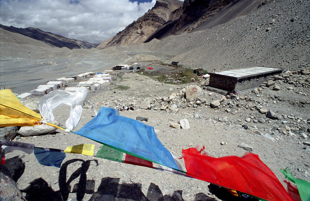 Tents at Mt. Everest base camp and Tibetan Buddhist prayer flags.