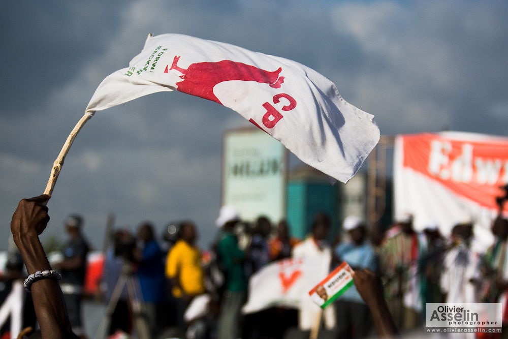 A Convention People's Party (CPP) supporter waves a flag during a rally in Accra, Ghana on Sunday September 21, 2008.