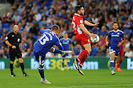 Cardiff City's Anthony Pilkington (blue) volleys at goal while being challenged by Blackburn's Craig Conway. EFL Skybet championship match, Cardiff city v Blackburn Rovers at the Cardiff city stadium in Cardiff, South Wales on Wednesday 17th August 2016.<br /> pic by Carl Robertson, Andrew Orchard sports photography.