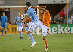 August 4, 2018 - Houston, TX, U.S. - HOUSTON, TX - AUGUST 04:  Houston Dynamo midfielder Darwin Ceren (24) attempts to volley the ball away from Sporting Kansas City midfielder Graham Zusi (8) during the soccer match between Sporting Kansas City and Houston Dynamo on August 4, 2018 at BBVA Compass Stadium in Houston, Texas.  (Photo by Leslie Plaza Johnson/Icon Sportswire) (Credit Image: © Leslie Plaza Johnson/Icon SMI via ZUMA Press)