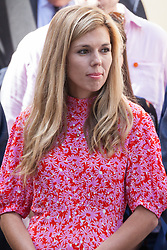 London, UK. 24 July, 2019. Carrie Symonds, Boris Johnson's girlfriend, waits for him to arrive in Downing Street as Prime Minister for the first time, having been formally appointed by the Queen shortly before at Buckingham Palace.
