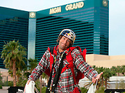 Travis Pastrana gathers his parachute after base jumping off The Signature at the MGM Grand Hotel & Casino on Wednesday June 1, 2011 in Las Vegas to promote the North American debut of Nitro Circus Live at the MGM Grand Garden Arena on Saturday June 4, 2011. (Jeff Bottari/AP Images for Nitro Circus Live)