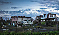 Damaged homes in Point Aux Chenes, Louisiana.