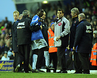Emile Heskey is dragged away by Manager Steve Bruce after his sending off as he argues with the 4th official<br />Birmingham City 2005/06<br />Birmingham City V Arsenal 04/02/06 at St' Andrews<br />The Premier League<br />Photo Robin Parker Fotosports International