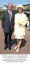 BARONESS JAY and her husband PROF.MICHAEL ADLER at a racemeeting in Berkshire on 24th July 2004.PXK 8