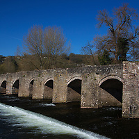 Europe, United Kingdom, Wales, Crickhowell. Stone brige over the river Usk.