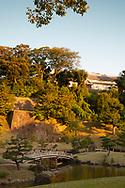 A bridge and pond in the Gyokusen'in maru Garden in Kanazawa, Ishigawa, Japan