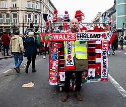 A street vendor showing scarves<br /> <br /> Photographer Simon King/Replay Images<br /> <br /> Six Nations Round 3 - Wales v England - Saturday 23rd February 2019 - Principality Stadium - Cardiff<br /> <br /> World Copyright © Replay Images . All rights reserved. info@replayimages.co.uk - http://replayimages.co.uk