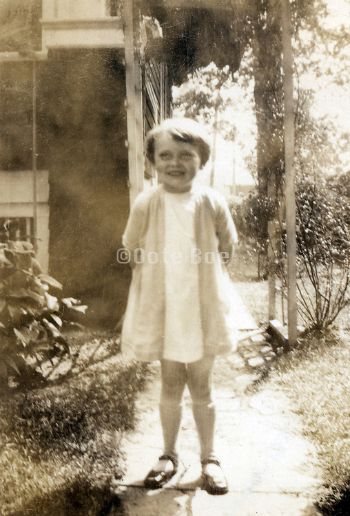 A little girl standing outdoors