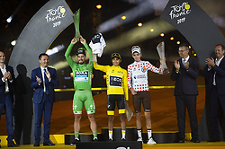 Slovakia's Peter Sagan, wearing the best sprinter's green jersey (L), Colombia's Egan Bernal, wearing the overall leader's yellow jersey (C) and France's Romain Bardet, wearing the best climber's polka dot jersey celebrate on the podium of the 21st and last stage of the 106th edition of the Tour de France cycling race between Rambouillet and Paris Champs-Elysees, in Paris, France on July 28, 2019. Photo by Eliot Blondet/ABACAPRESS.COM